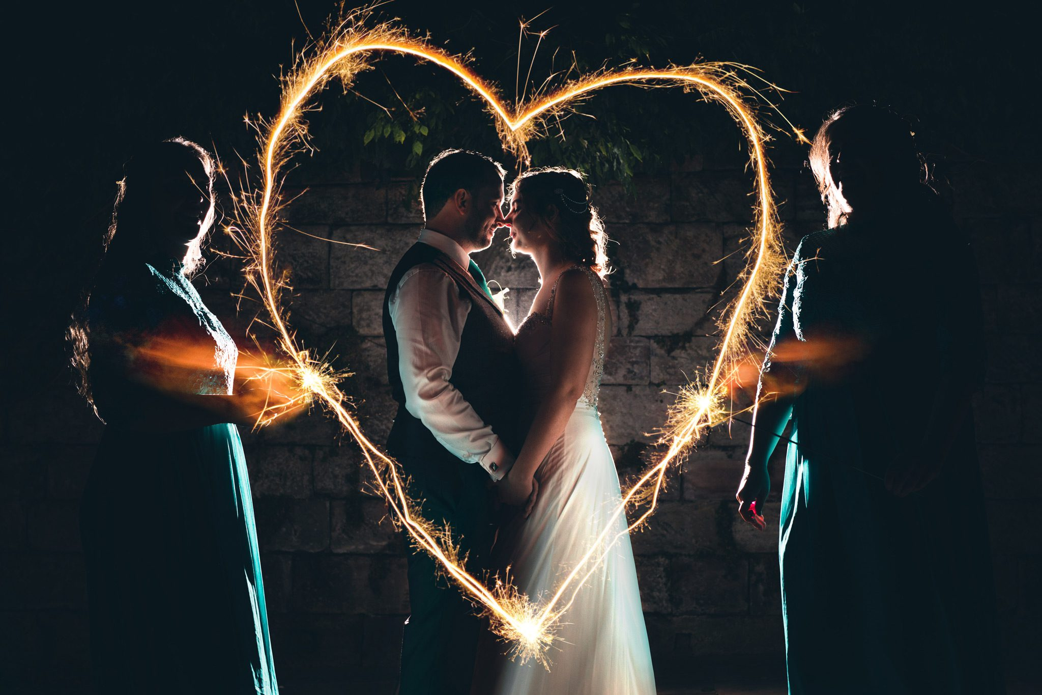 Bride and Groom with sparkler heart at Castlefield Rooms