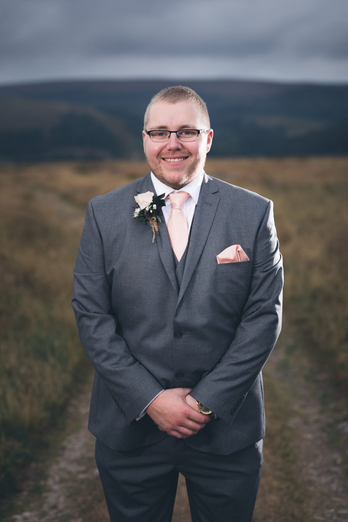 Groom under a moody sky at the Goyt Valley
