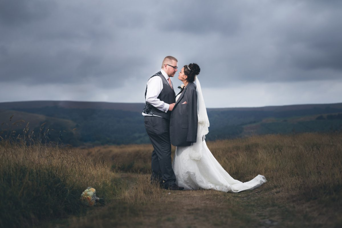 Bride and Groom under a moody sky at the Goyt Valley