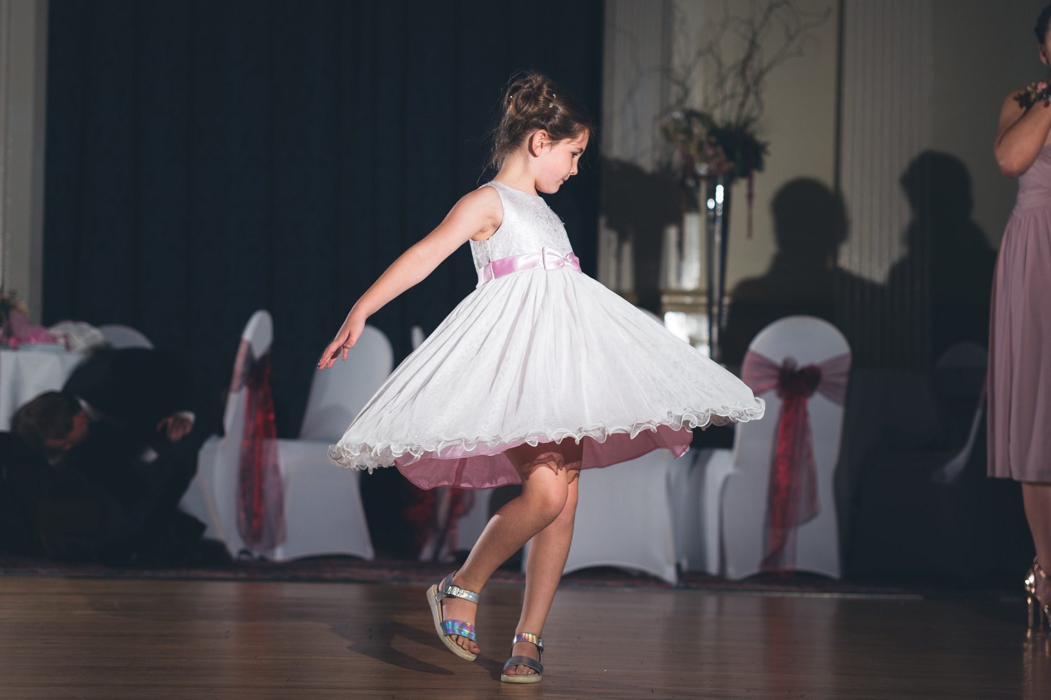 Girl twirling her dress at Buxton Wedding