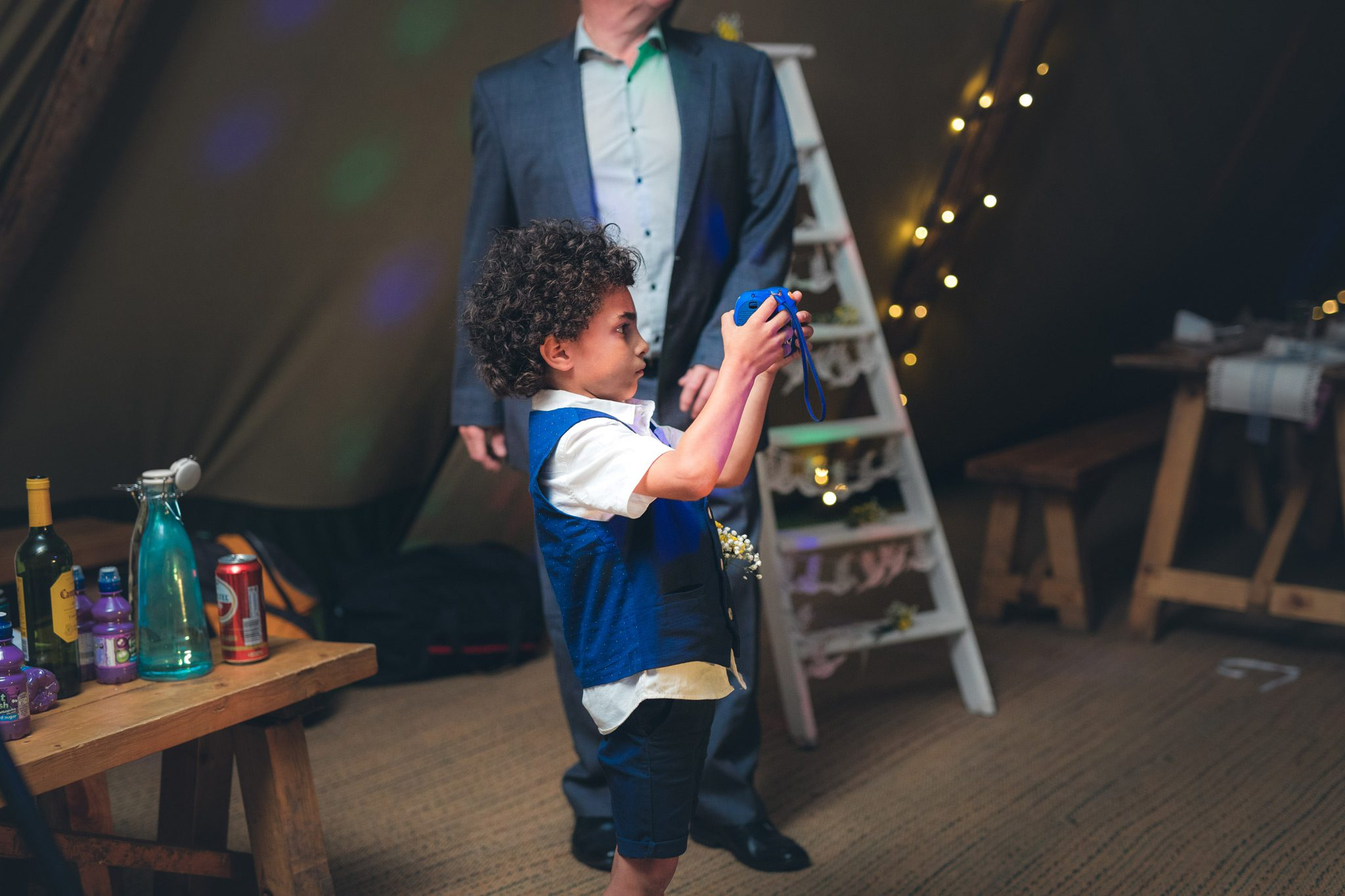 Child taking a photo at a wedding