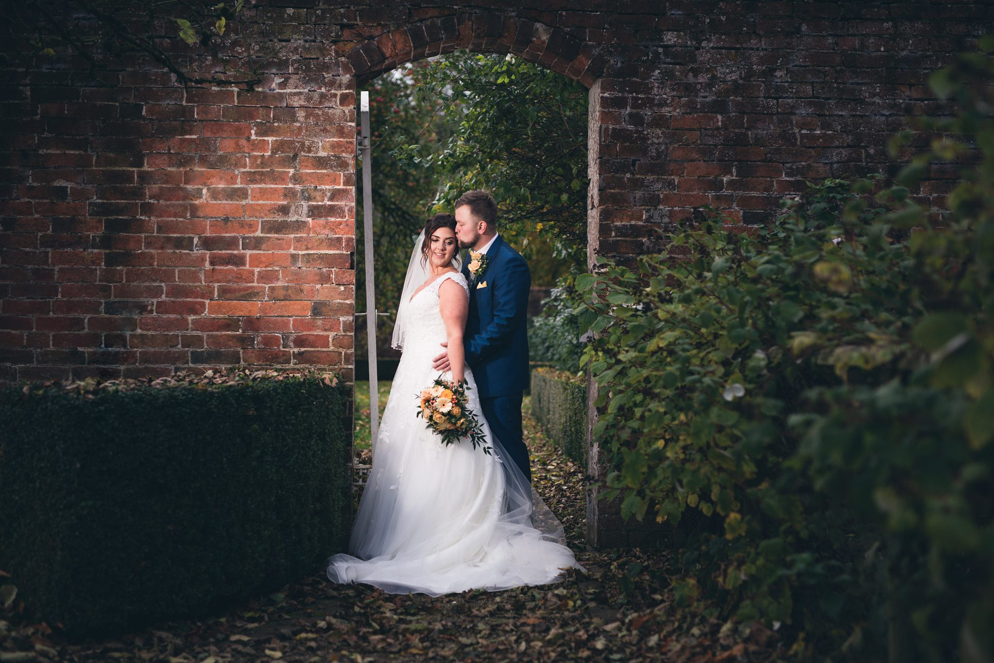 Couple hugging in the garden at Yeldersley Hall