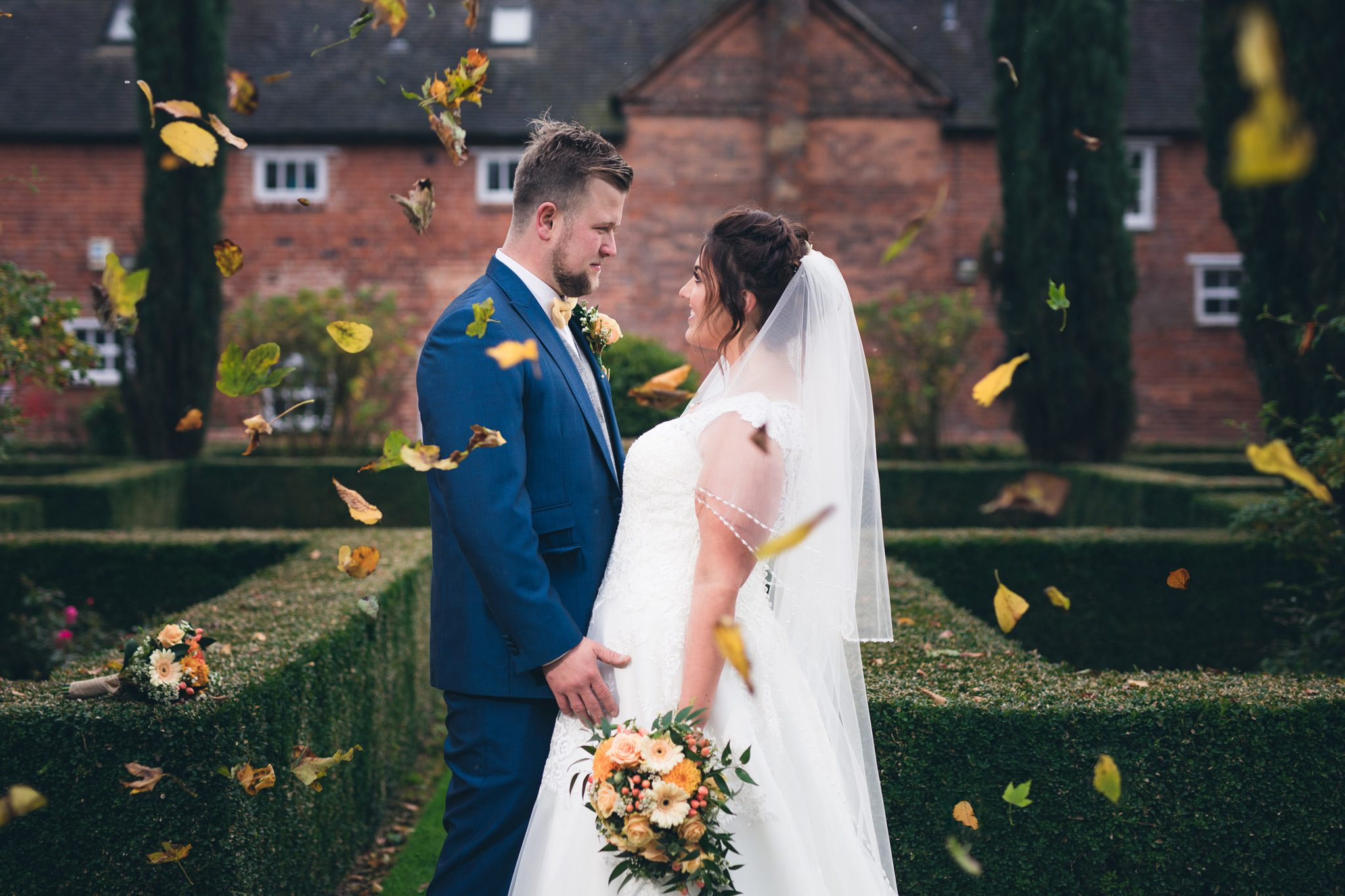 Leaves dropping on the couple at Yeldersley Hall
