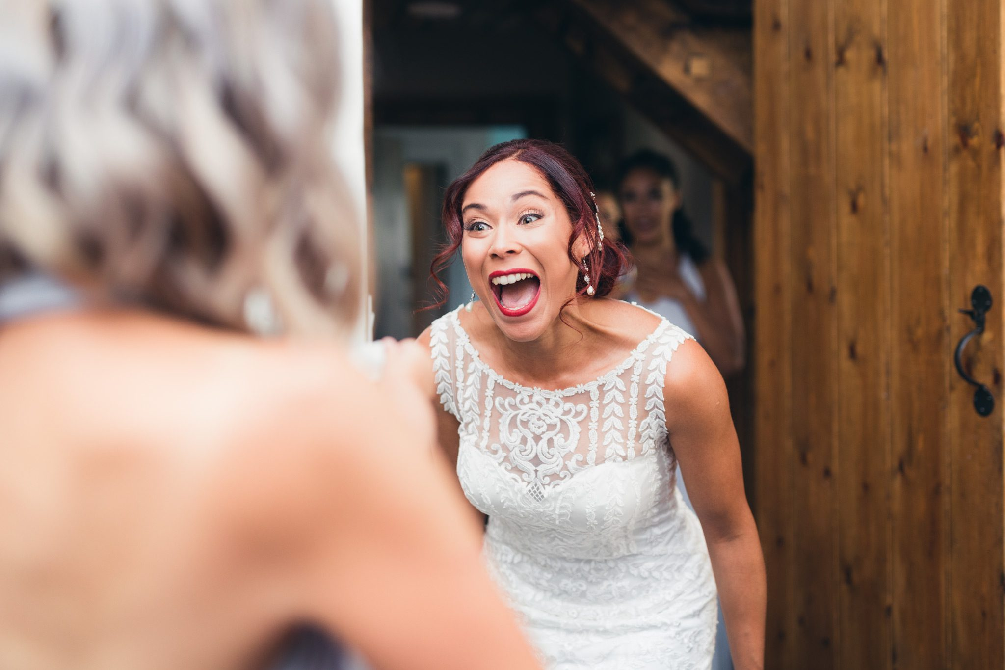 the bride getting excited with her guests as they see her for the first time