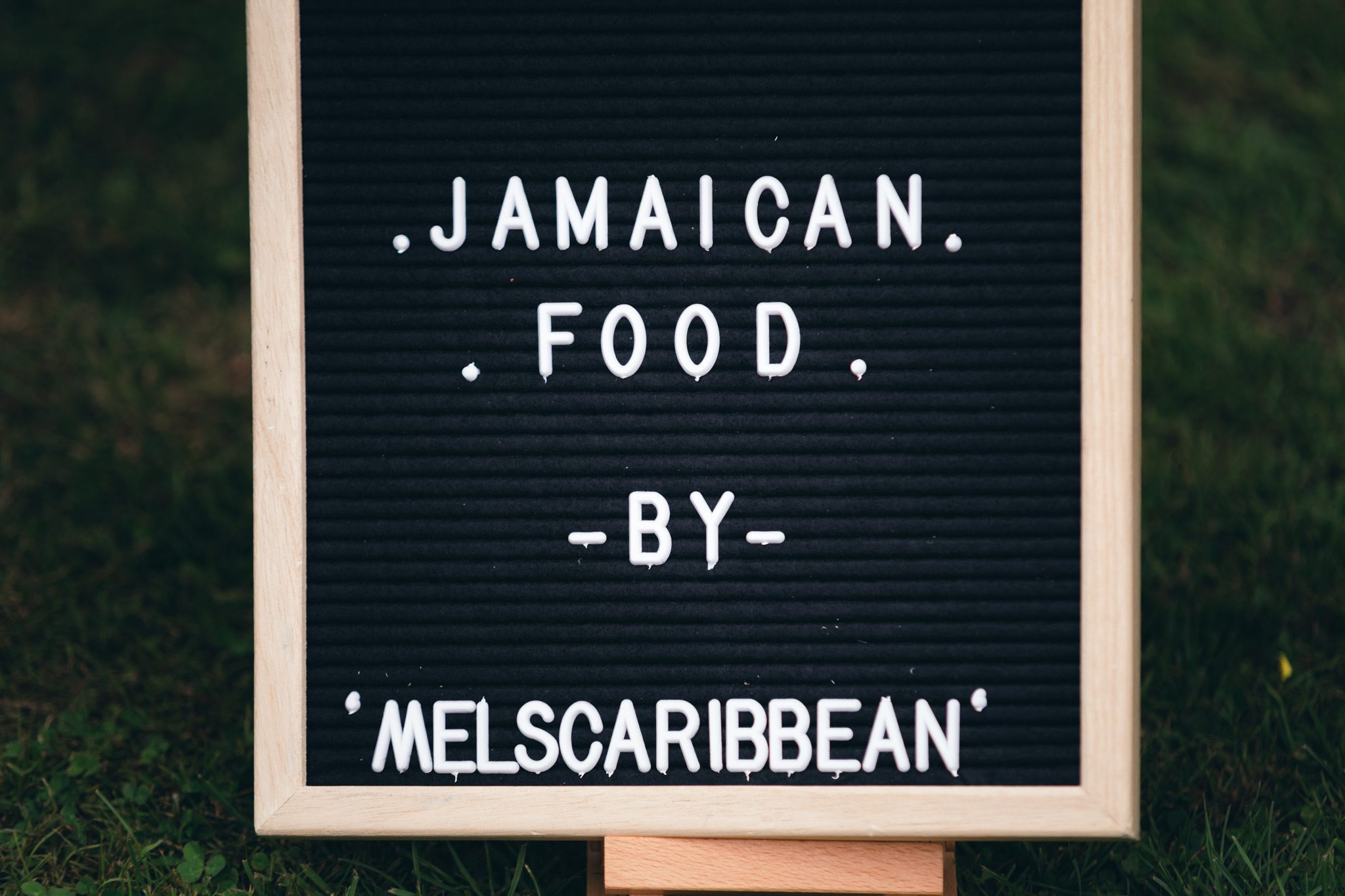 Jamaican food by Mel's Caribbean catering sign