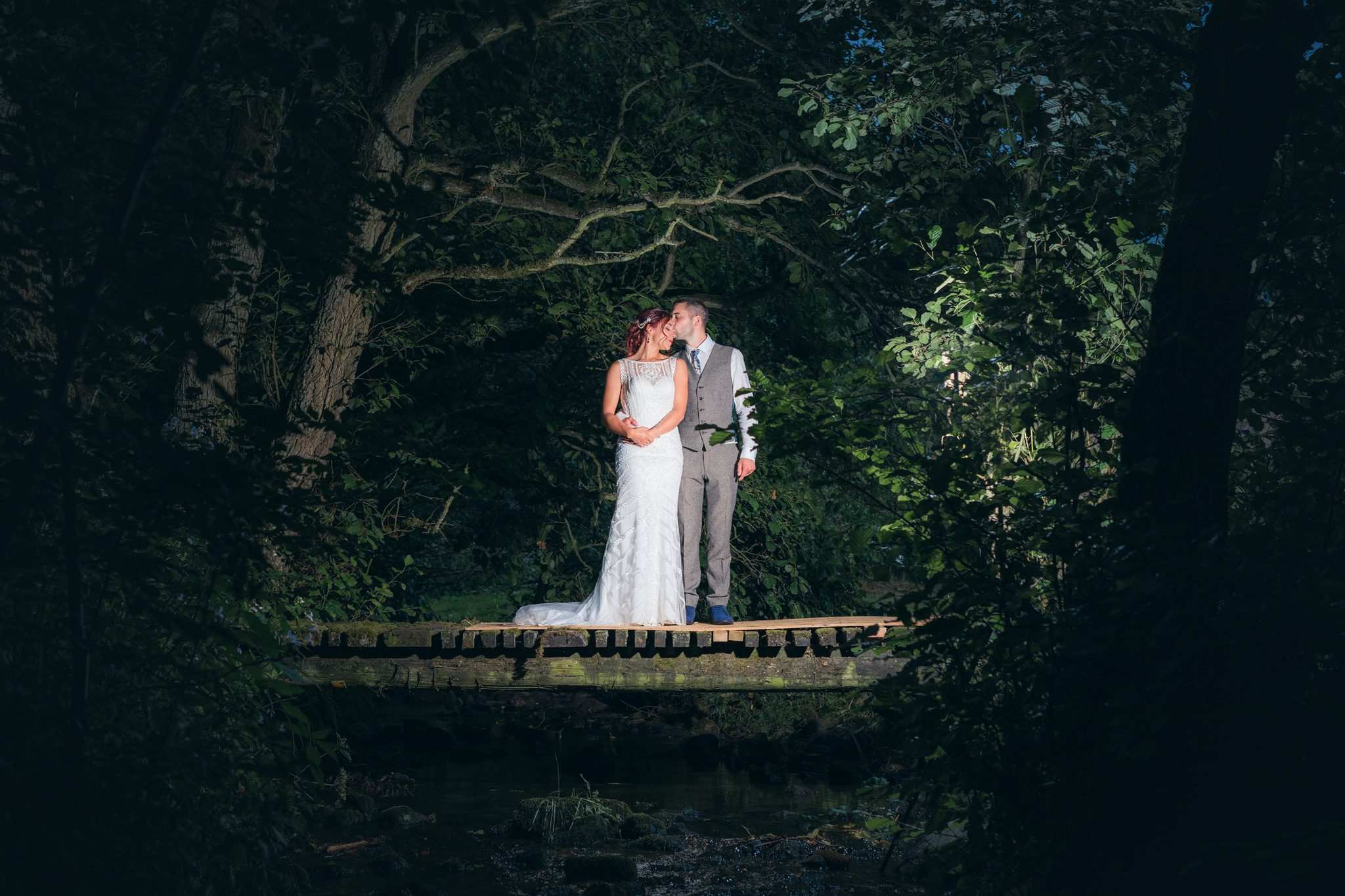 bride and groom enjoying a peaceful moment on a bridge in the Peak District