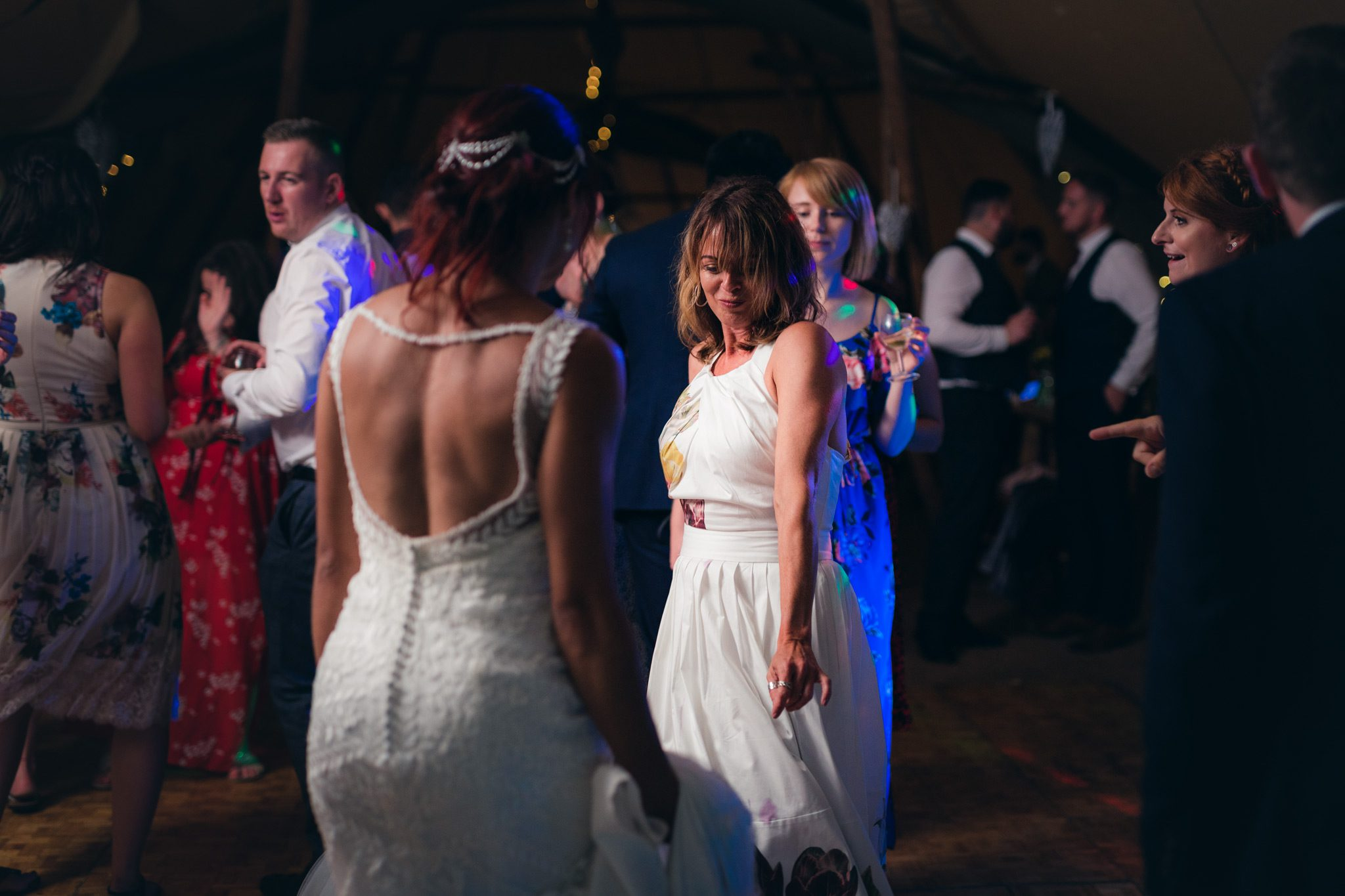 the bride and her mum dancing on the dance floor at a tipi wedding in the Peak District