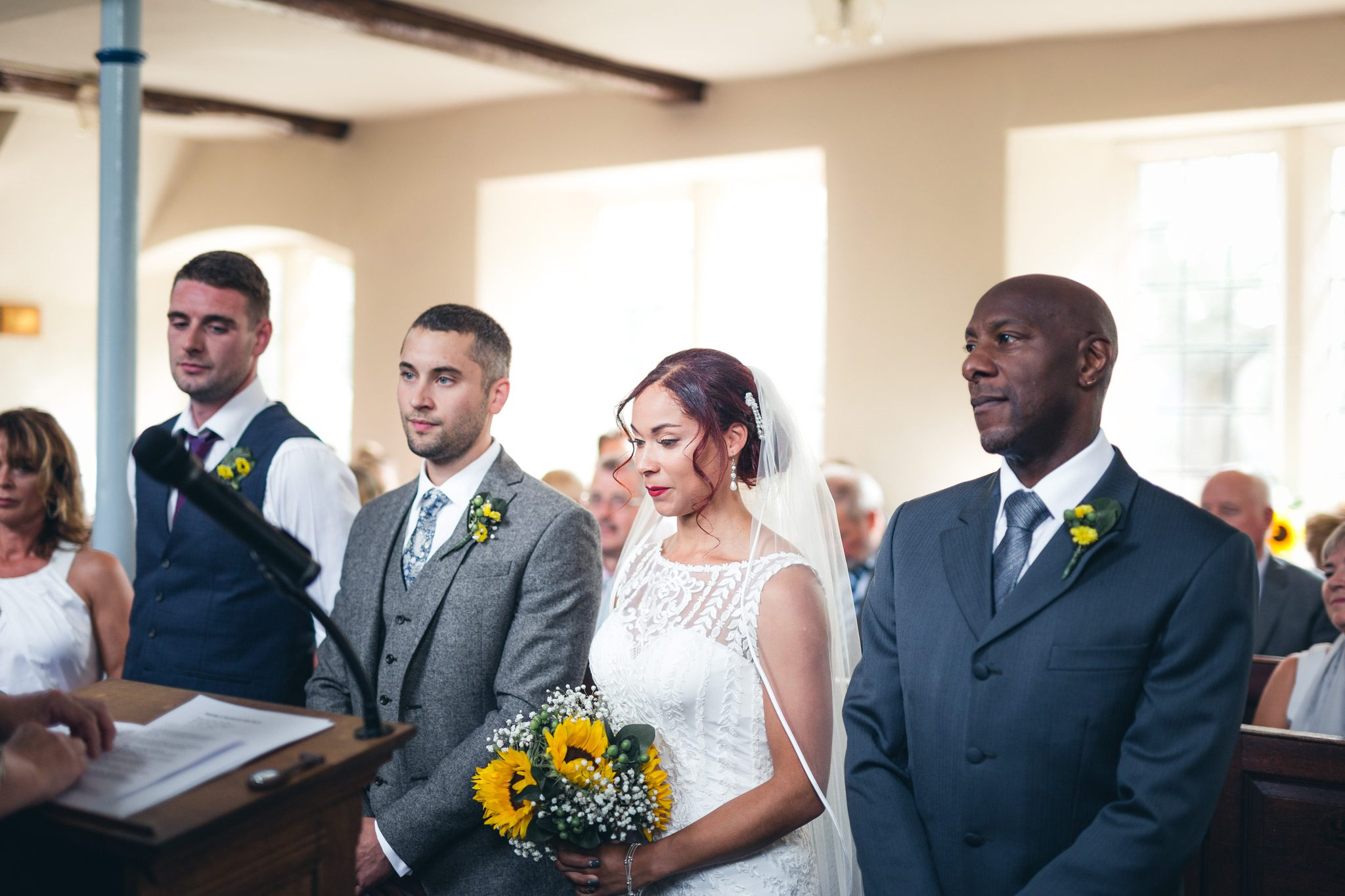 bride and groom waiting to say their vows in a peak district church