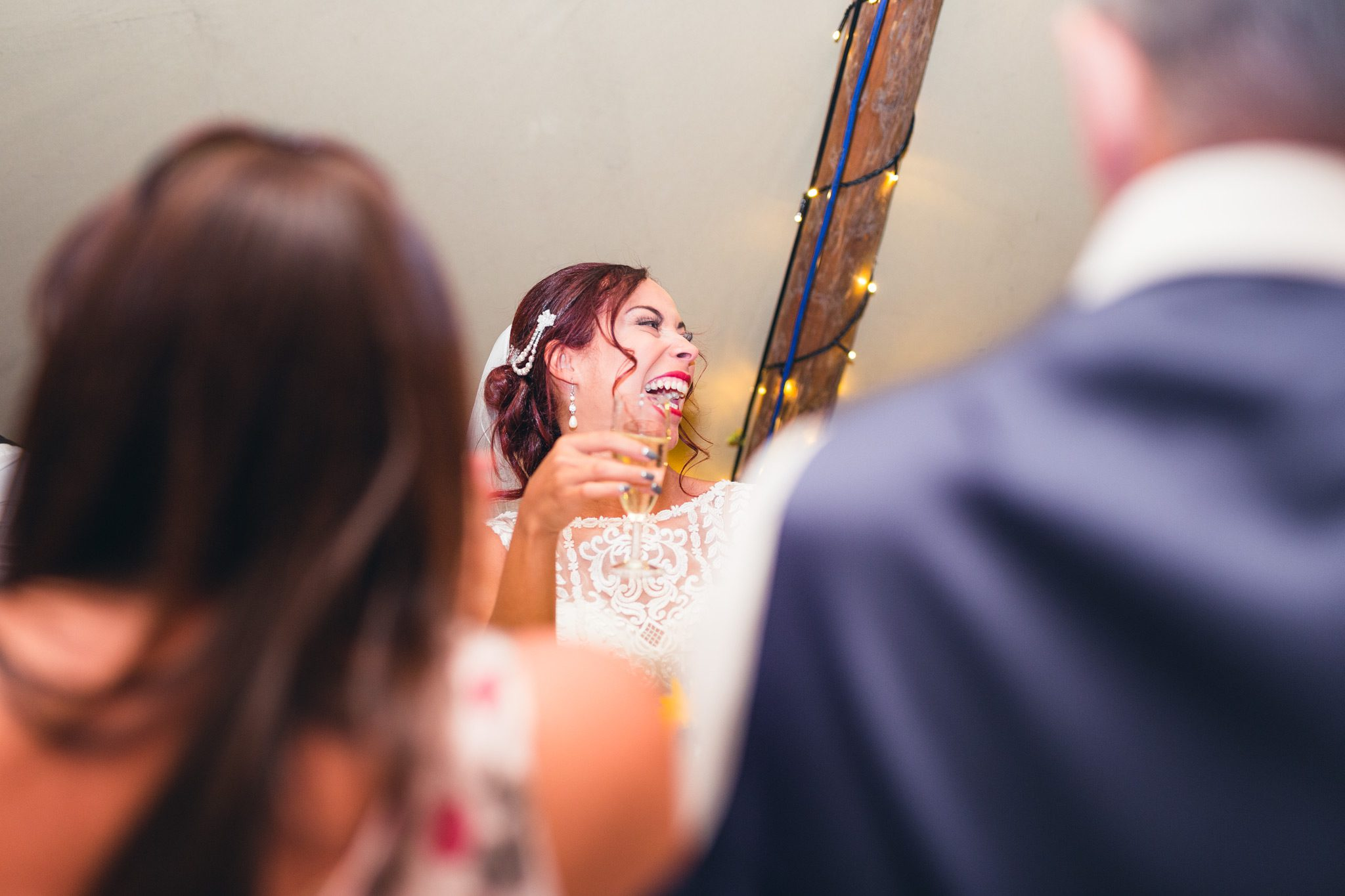 bride laughing at her dads speech at a tipi wedding in the peak district