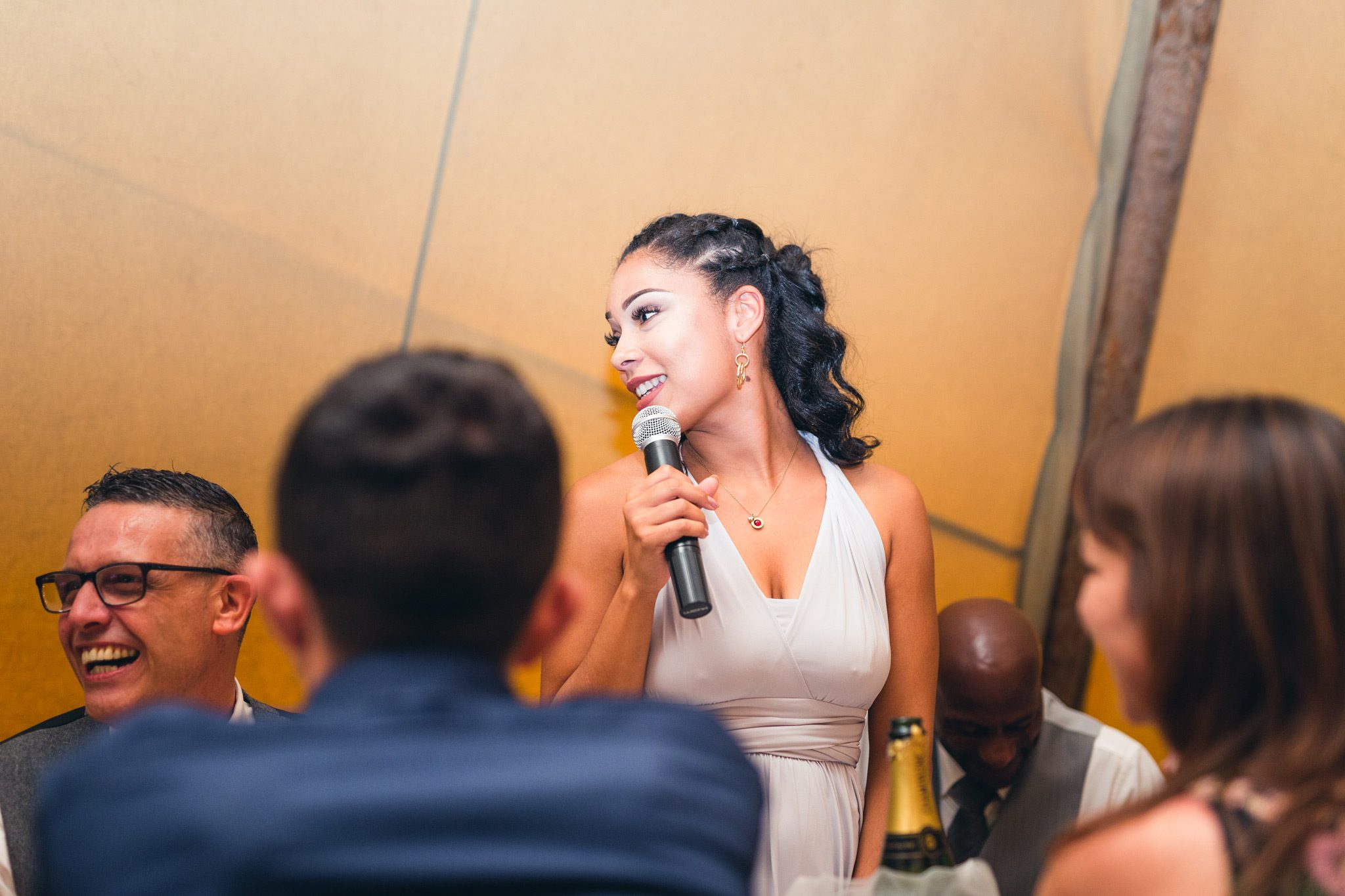 bridesmaid giving her speech to the guests at a tipi wedding in the peak district