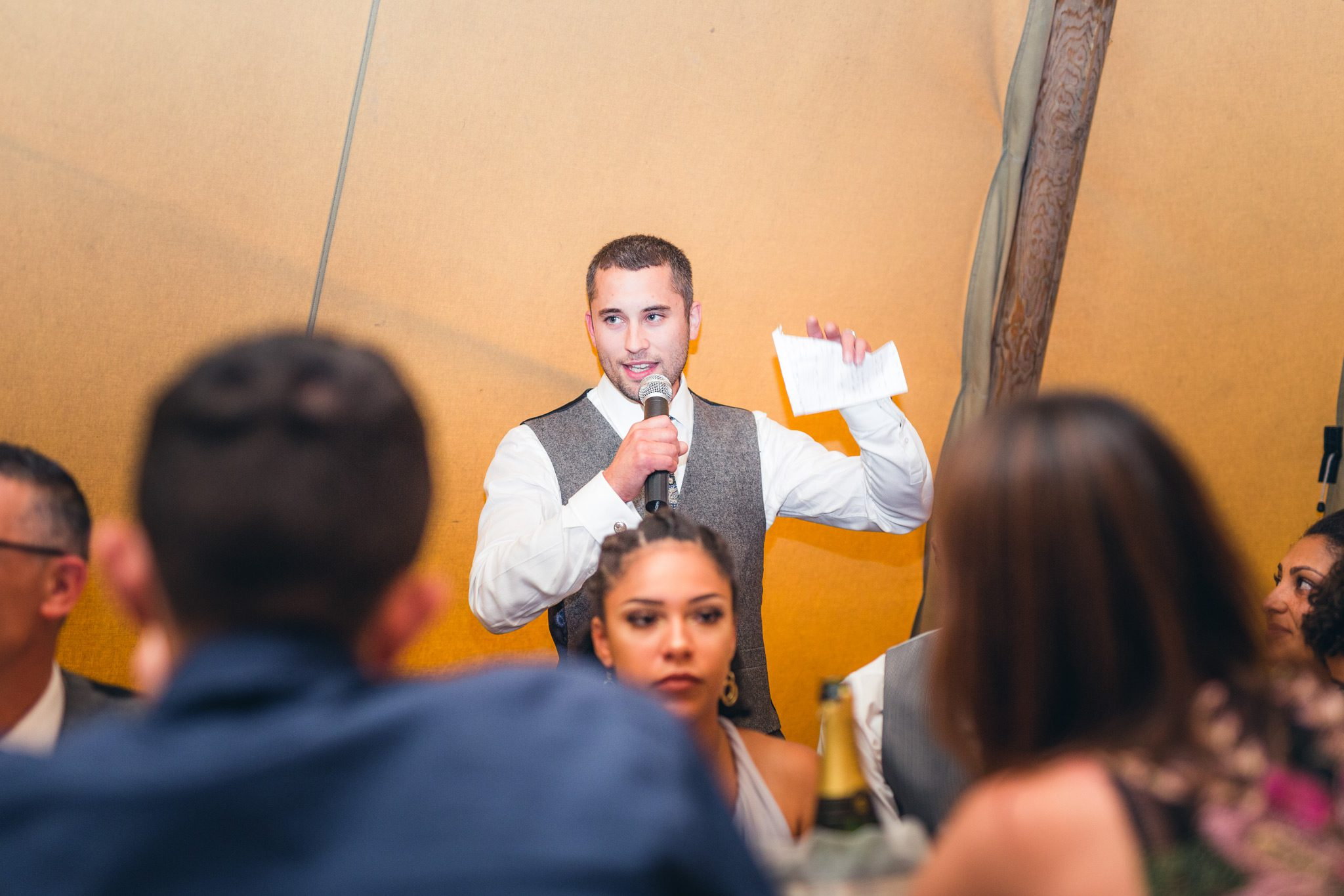 groom giving his speech to the guests at a tipi wedding in the peak district