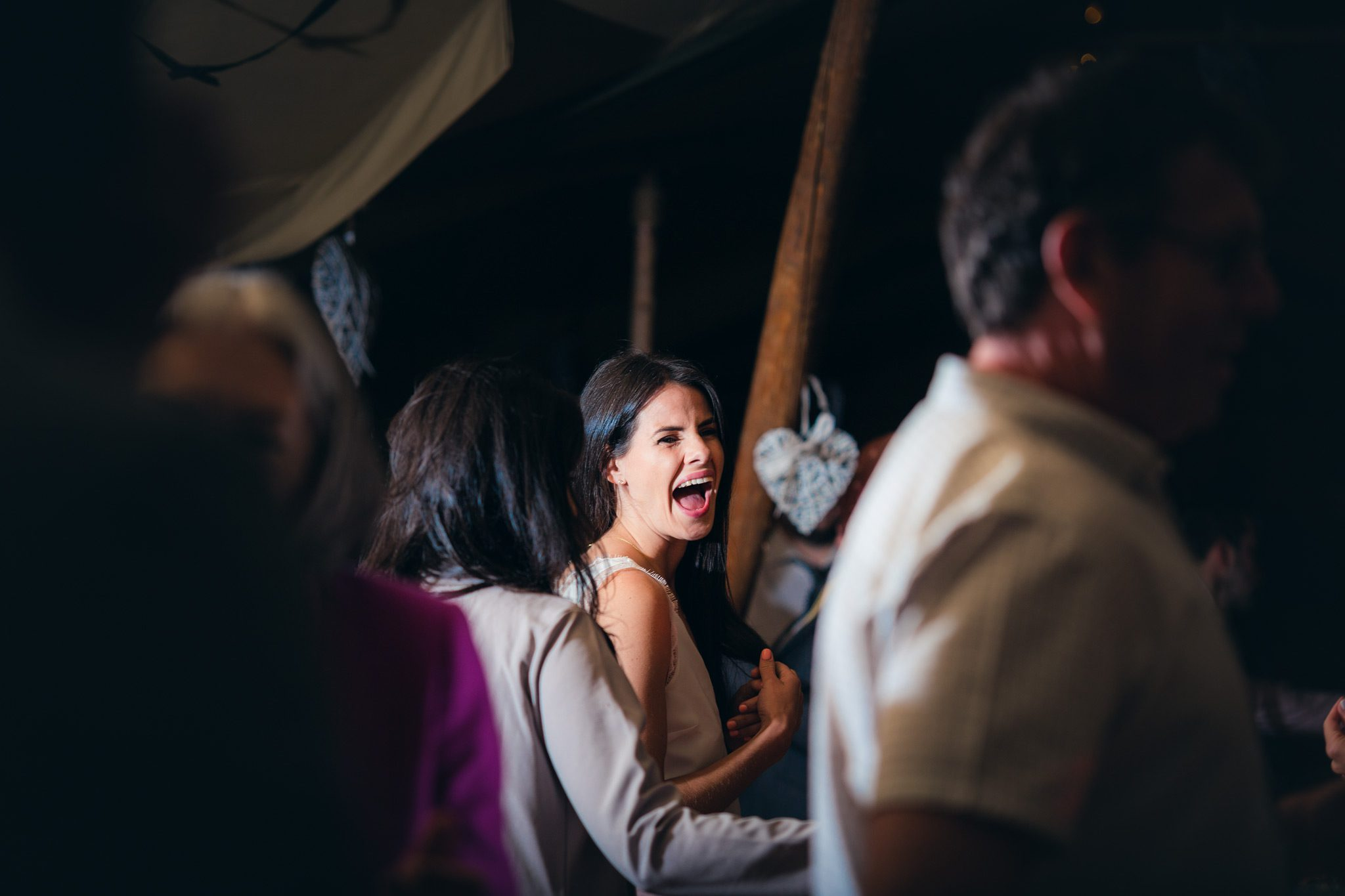 Guest laughing on the dance floor in the tipi
