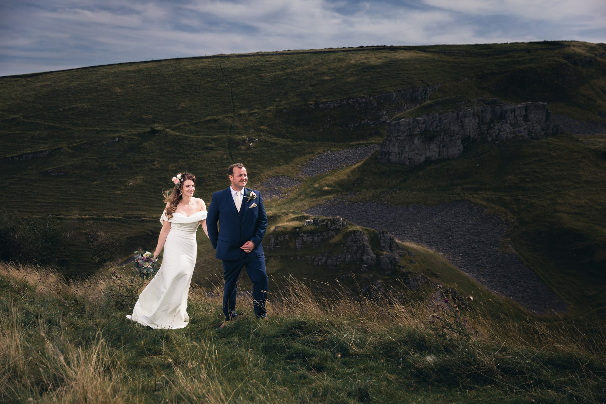 Bride and Groom walking through the Peak District