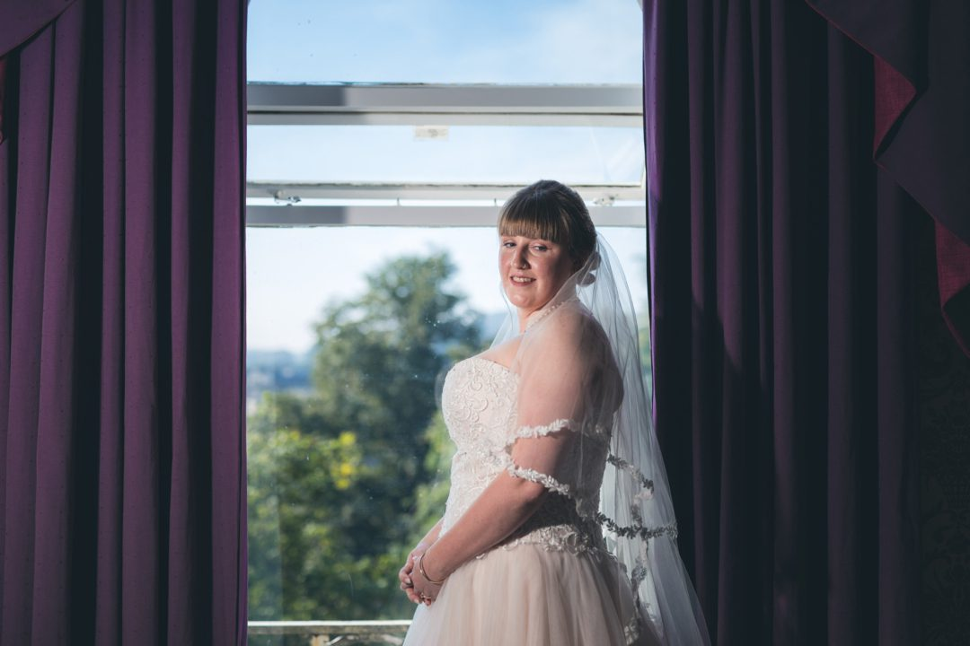 bride stood in front of the window