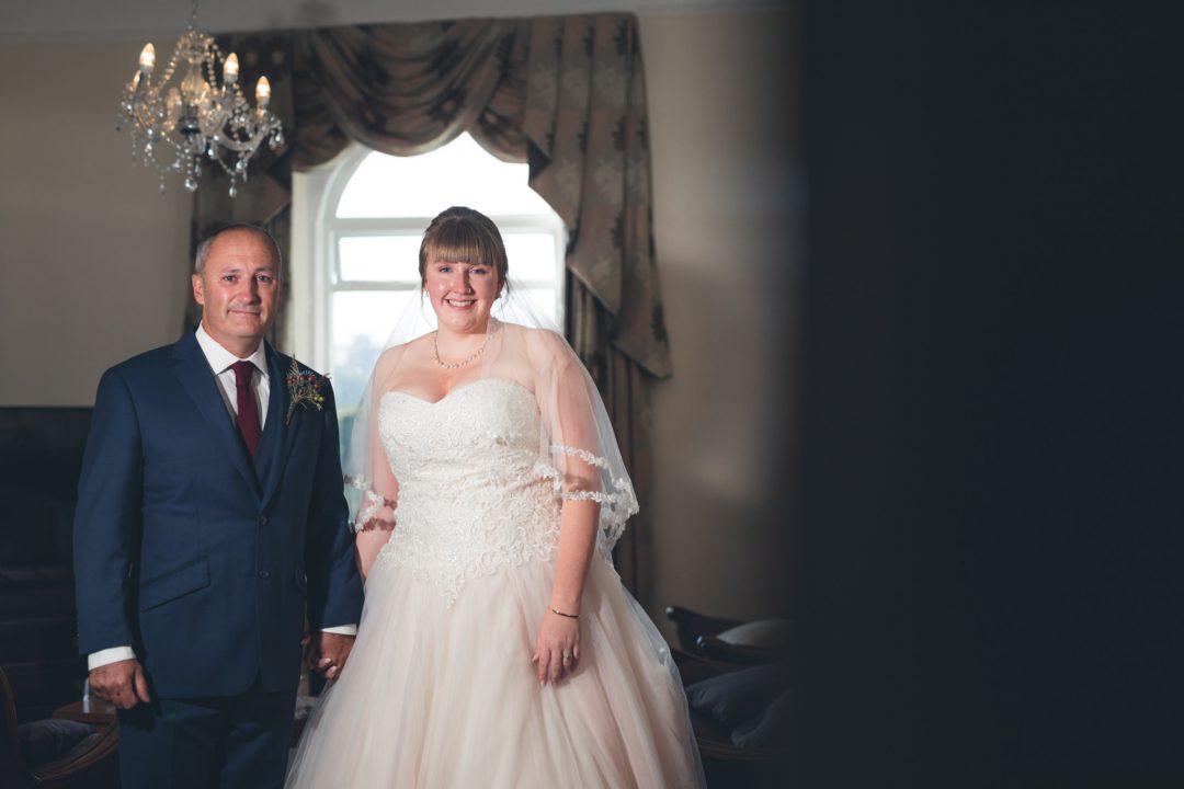 bride and dad stood together
