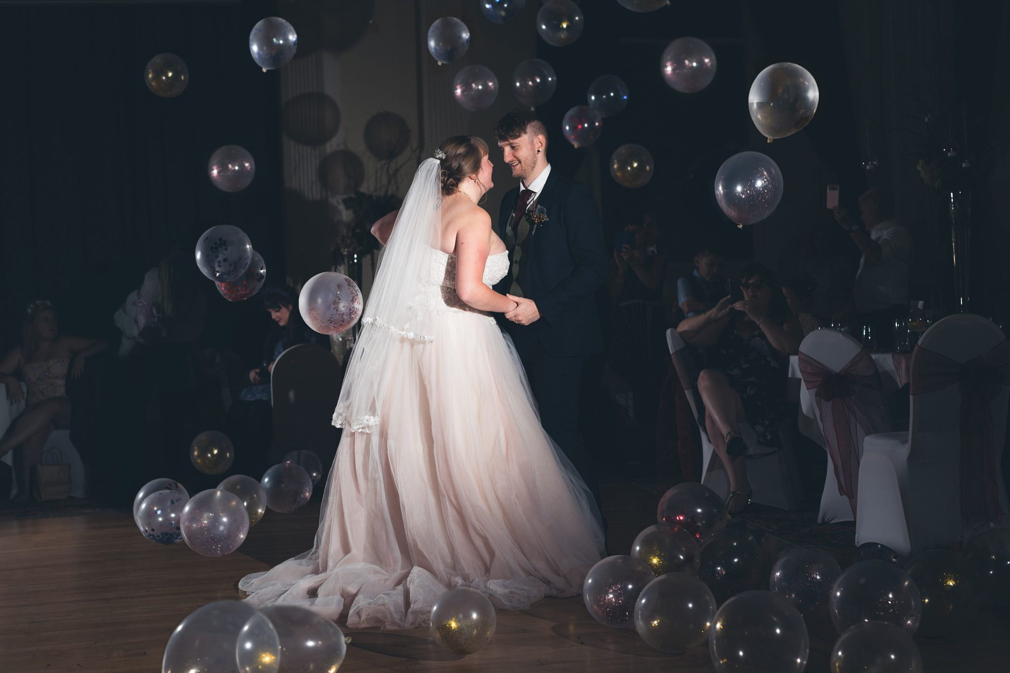 balloons falling during the bride and grooms first dance
