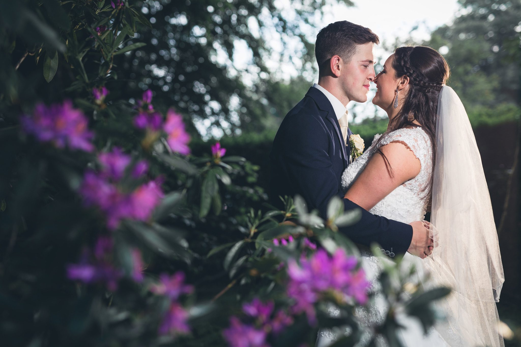 Wedding couple in love through the flowers