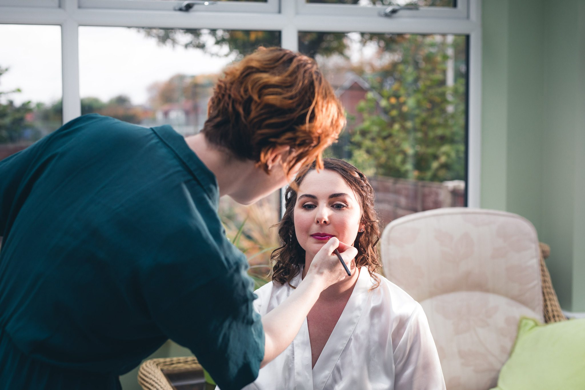 Bride having make up done in Manchester