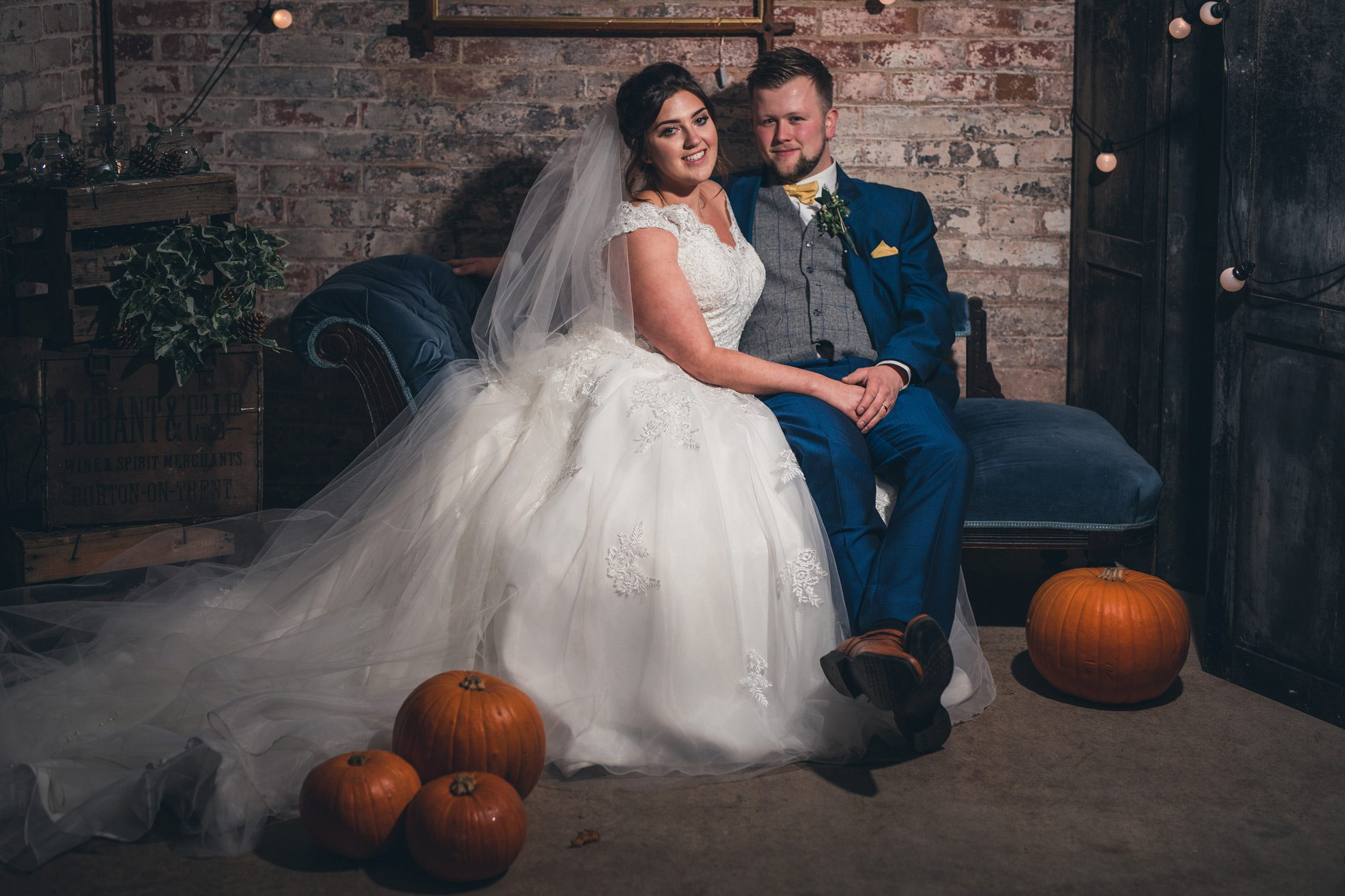 Couple with pumpkins at Yeldersley Hall