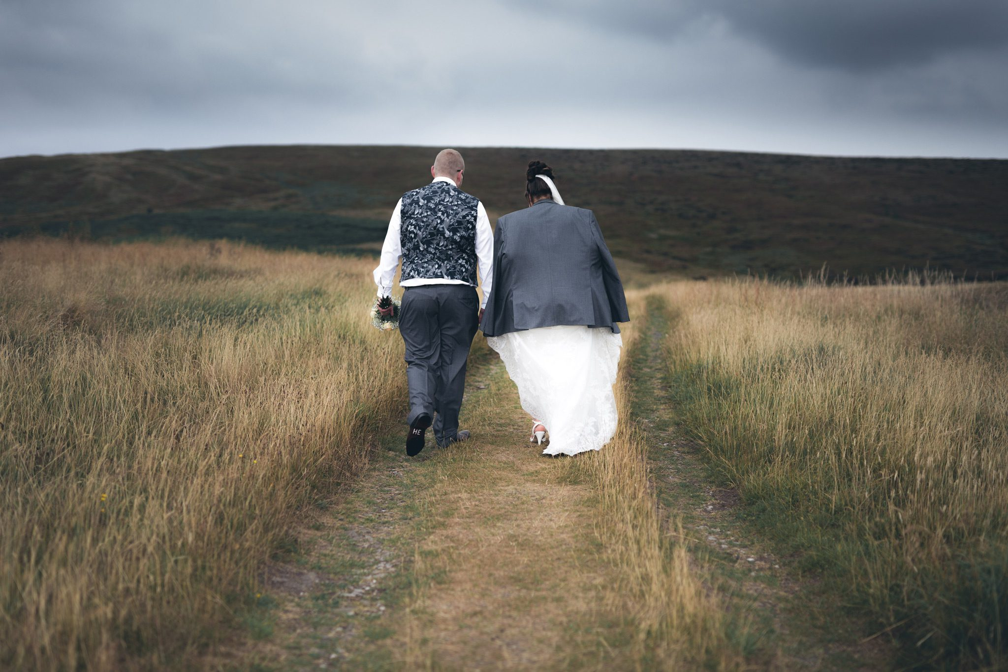 Bride and Groom walking through the Goyt Valley